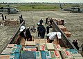 US Navy 050104-N-9293K-062 Sailors and aid workers work together to load food and relief supplies at Sultan Iskandar Muda Air Force Base in Banda Aceh, Sumatra, Indonesia.jpg