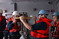 US Navy 050210-N-4702D-079 Machinist Mate 2nd class Manuel Luttrell spins the riser to initiate a fuel transfer from the Military Sealift Command (MSC) underway replenishment oiler USNS Yukon (T-AO 202) during an underway reple.jpg