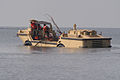 US Navy 050914-N-0793G-004 Beachmasters use a Logistical Amphibious Recovery Craft (LARC) amphibious vehicle assigned to Beachmaster Unit Two (BMU-2) to remove debris out of the water.jpg