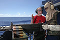 US Navy 060612-N-3946H-060 Gunner's Mate 2nd Class Teresa Keener instructs a Sailor assigned to the Weapons Department on the operation of a .50-caliber machine gun.jpg