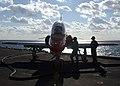 US Navy 061212-N-1121F-011 Aviation boatswain mates fuel a T-45 Goshawk before flight operations on board USS Theodore Roosevelt (CVN 71).jpg