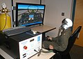 US Navy 070216-N-6247M-009 Lt. Cmdr. James McAllister, from San Diego, Calif. sits in the simulator during a test flight using the new Reduced Oxygen Breathing Device (ROBD).jpg