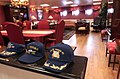 US Navy 070316-N-9712C-001 Hats belonging to Japan Maritime Self Defense Force (JMSDF) officials sit on top of the counter in the commanding officer's office while their owners tour Nimitz-class aircraft carrier USS Ronal.jpg