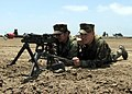 US Navy 070627-N-8547M-003 Engineers Aide 3rd Class Marie Buencilla and Equipment Operator 3rd Class Derek Prez, of Naval Mobile Construction Battalion (NMCB) 5, man a M240B machine gun.jpg