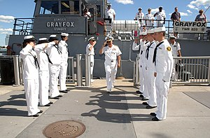 USNSCS Grayfox (TWR-825) - Vice Admiral Terrance Etnyre, commander of Naval Surface Force, U.S. Pacific Fleet, salutes the Sea Cadets performing as sideboys of the U.S. Naval Sea Cadet training ship Grayfox (TWR 825), Detroit Navy Week, 2007