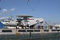 US Navy 071205-N-9520G-001 USS Kitty Hawk (CV 63) Sailors and Japanese contractors work together to secure an E-2C Hawkeye to a barge for transport to Naval Air Facility Atsugi for repairs.jpg