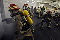 US Navy 081114-N-3659B-521 Sailors battle a simulated class bravo fire.jpg