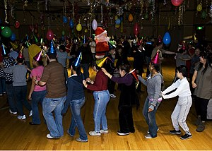 Conga line - A conga line formed during a Christmas disco party.