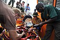 US Navy 090326-N-5242D-022 Navy divers and a Uganda Peoples Defense Force Cpl. perform a pre-mission check on a KM-37 deep-sea diving helmet.jpg