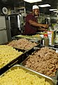 US Navy 090914-N-5345W-130 Culinary Specialist Seaman Gregory Lucas gathers ingredients to prepare lunch in the galley aboard the amphibious dock landing ship USS Fort McHenry (LSD 43).jpg
