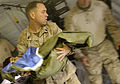 US Navy 090925-M-2581P-835 Chief Hospital Corpsman Clarence Connor carries an Afghan boy to a stretcher at Forward Operating Base Geronimo, Helmand Province, Afghanistan.jpg