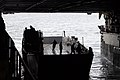 US Navy 100115-N-7653W-015 Crew members aboard the amphibious dock landing ship USS Fort McHenry (LSD 43) perform wet well deck operation exercises off the.jpg