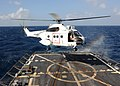 US Navy 100219-N-7088A-008 A helicopter lands aboard USS Farragut (DDG 99) during a vertical replenishment at sea.jpg