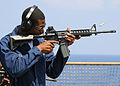 US Navy 100321-N-1082Z-184 Hospital Corpsman Seaman Richard L. Williams shoots an M16 service rifle during a weapons qualification.jpg