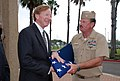 US Navy 100430-N-4913K-002 Capt. Leland Taylor, commanding officer of Naval Station Ingleside, Texas, presents the national ensign to Mike Carrell, chairman of the Port Commission for the Port of Corpus Christi Authority.jpg