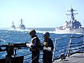 US Navy 100507-N-3929G-001 USS Momsen (DDG 92), USS Shoup (DDG 86) and USS Sterett (DDG 104) cruise in formation behind USS Halsey (DDG 97) firing synchronized five-inch gunfire and crew served weapons.jpg