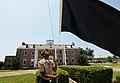 US Navy 100524-N-5328N-633 Cryptologic Technician (Technical) Seaman Antron Johnson-Gray, a student at the Center for Information Dominance Corry Station, raises the black flag for the first time in 2010.jpg