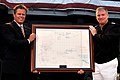 US Navy 100605-N-3038W-174 Adm. Patrick Walsh presents Rear Adm. John McLaughlin (Ret.) a framed replica of the Battle of Midway battle plans for the USS Midway (CV 41) Museum.jpg