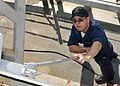 US Navy 100708-N-2013O-007 Sonar Technician (Surface) Seaman Johnny Velazquez, from Chicago, paints an exterior bulkhead during ship preservation efforts aboard the Arleigh Burke-class guided-missile destroyer USS Stethem (DDG.jpg