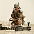 US Navy 100712-N-0490C-003 A Sailor operates a small unmanned ground vehicle to gather situational awareness during a training evolution to locate, identify, render safe and dispose of an improvised explosive device (IED).jpg