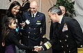 US Navy 101211-N-6138K-021 Vice Adm. Harry B. Harris Jr. introduces himself to Italian navy Capt. Francesco Tomas during a holiday reception for th.jpg