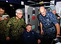 US Navy 110331-N-SB673-071 Rear Adm. Robert Girrier, right, and Operations Specialist 2nd Class Nick Suarez, center, explain operations supporting.jpg