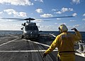 US Navy 111214-N-FI736-339 Boatswain's Mate 1st Class Jeffery Ellis signals an SH-60B Sea Hawk helicopter, assigned to Helicopter Anti-Submarine Sq.jpg