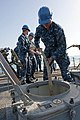 US Navy 120206-N-VY256-048 A Sailor feeds a mooring line into a storage trunk.jpg