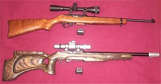 Accurizing - Ruger 10/22 carbines, before accurizing (top) and after (below). Externally visible changes are the target-style stock, the more vertical thumbhole grip, the free-floated bull barrel, and a muzzle brake.
