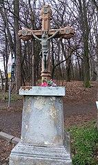 Rozlučkový kříž na okraji Ctěnického háje u zastávky autobusu