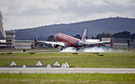 Virgin Blue (VH-ZPF) Embraer ERJ-190AR touches down at Canberra Airport.jpg