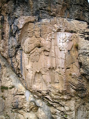 White wine - The Hittite King Warpalawa offering a bunch of grapes to the god Tarhunta. A bas-relief in rock at Ivriz in Turkey from the beginning of the 1st millennium BC.