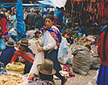 Woman with child on market Peru.jpg