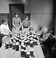 Women of Hovingham in Yorkshire stick labels on jars of jam at the village jam centre, October 1942. D10766.jpg