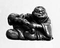 Wood clad masseur operates on left arm. Wellcome M0004146EB.jpg