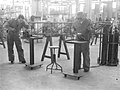 Workmen welding and filing in aircraft workshop (5570148337).jpg