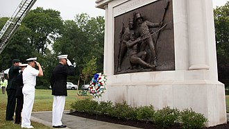 Chesapeake Bay Flotilla - U.S. Navy Honor Guard salute during August 23, 2014 dedication of official Battle Of Bladensburg Memorial by the State of Maryland, with the bronze relief sculpture showing a wounded Commodore Joshua Barney fighting alongside an unidentified marine and Flotilla sailor, Charles Ball