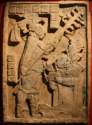 Yaxchilan - Lintel 24, structure 23, Yaxchilan. The sculpture depicts a sacred blood-letting ritual which took place on 26 October 709. King Itzamnaaj B'alam II is shown holding a torch, while his wife Lady K'ab'al Xook draws a barbed rope through her pierced tongue, British Museum.