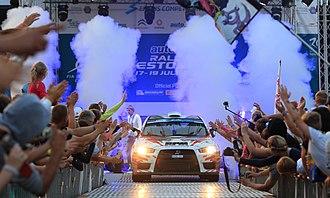 Rally Estonia - Alexey Lukyanuk (Mitsubishi Lancer Evo X) leaving the start podium on the 2014 rally.