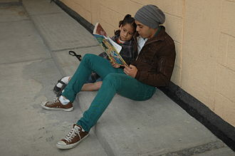 Reading - Volunteer reads to a girl at the Casa Hogar de las Niñas in Mexico City
