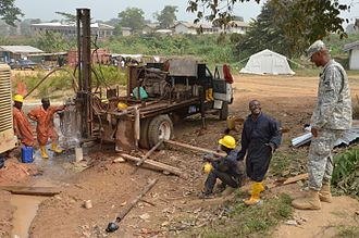 Tubmanburg - Liberians build a well at an Ebola treatment facility in Tubmanburg during the West African Ebola virus epidemic of 2014-2015