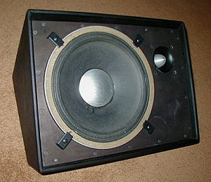 "Foldback (sound engineering) - A JBL floor monitor speaker cabinet with a 12"" woofer and a ""bullet"" tweeter. Typically, the speaker would be covered with a metal grille to protect it."