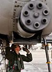 130110-f-oc707-003 Female Fighter Pilot Maj. Olivia Elliott completes preflight checks of her A-10 Thunderbolt II.jpg