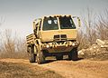2) Oshkosh-produced M1087 A1P2 2.5-ton LTV in A-kit confoguration.jpg