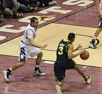 Tre Demps - Demps guarding Michigan's Trey Burke while at Northwestern