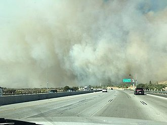 Creek Fire - Image of smoke coming from the Creek Fire on December 5, as the fire approached Interstate 210.