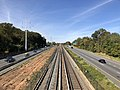 2018-10-25 11 43 36 View west along Interstate 66 (Custis Memorial Parkway) and the Orange and Silver lines of the Washington Metro from the pedestrian overpass connecting North Potomac Street to Madison Manor Park in Arlington County, Virginia.jpg