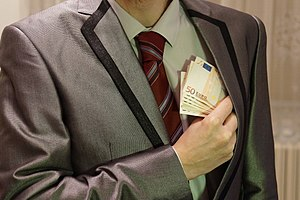 4 - corruption - man in suit - euro banknotes hidden in left jacket inside pocket - royalty free, without copyright, public domain photo image.JPG
