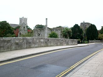 Listed buildings in Christchurch, Dorset - Five of the town's grade I listed structures. In the foreground, the mediaeval town and mews bridges; in the centre, the 12th-century Constable's House; in the background to the right, the Norman castle, and to the left, the Priory church.