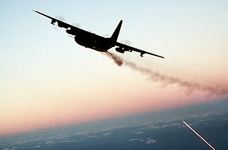 Gunship - A USAF AC-130 gunship fires one of its weapons during twilight operations in 1988